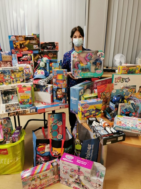 A nurse surrounded by presents