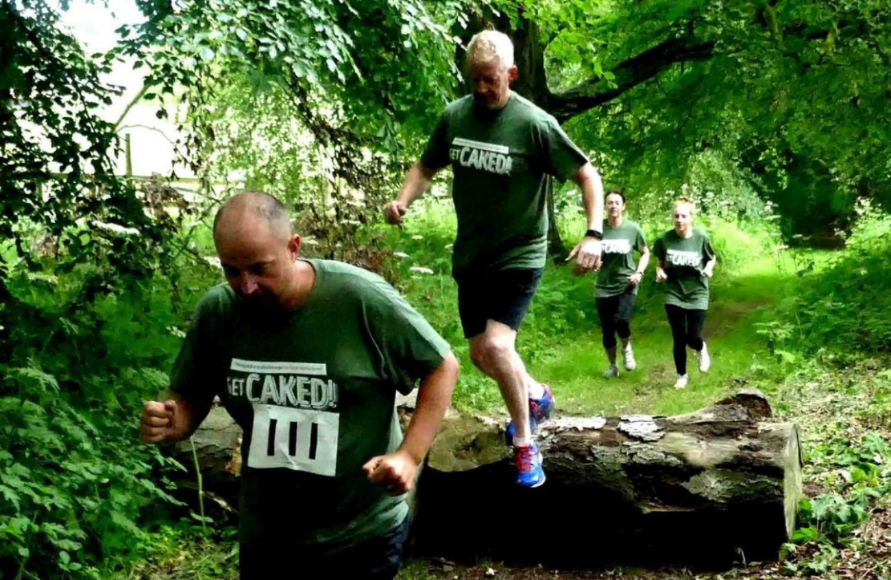 Four people run the Get Caked course