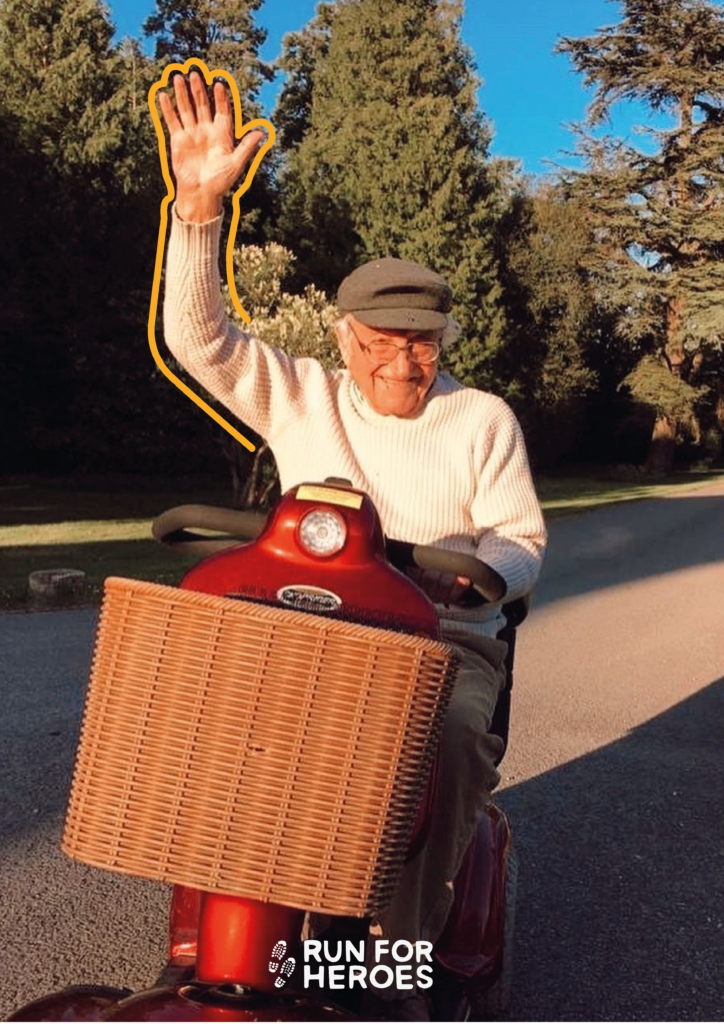 An elderly man on a mobility scooter takes part in the 5k May challenge