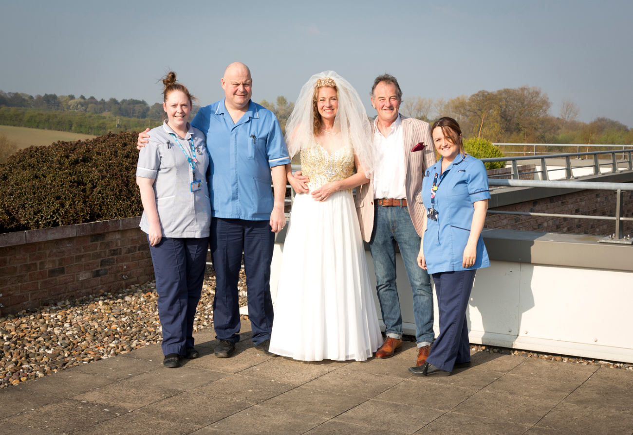 Bride, groom and Queen's Centre staff
