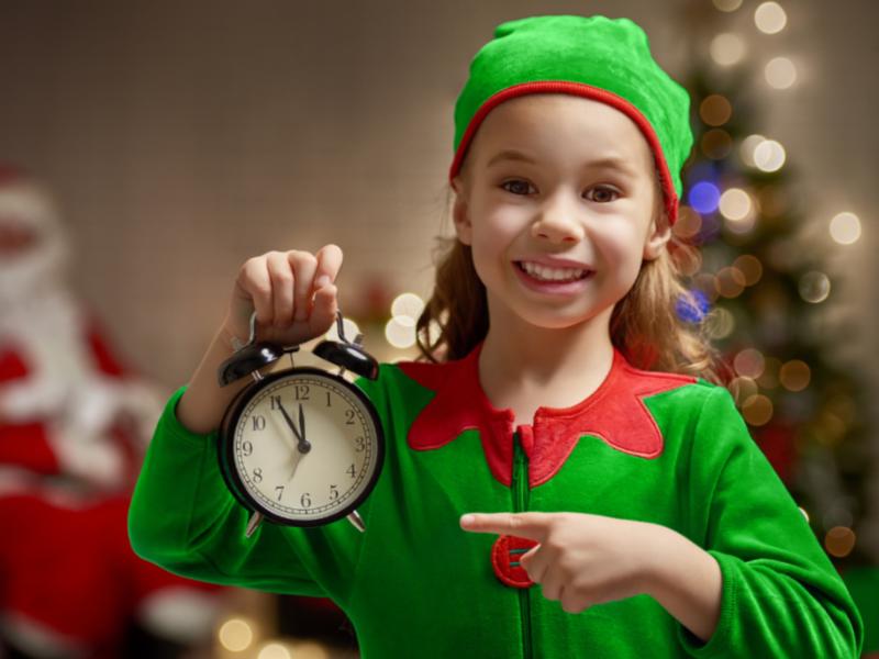 A little girl dressed like an elf