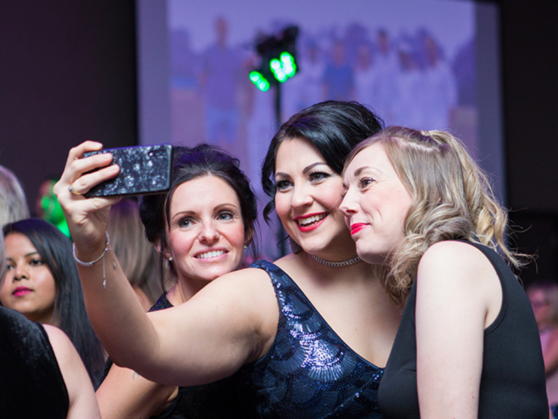 A group of ladies take a selfie at the WISHH Ball