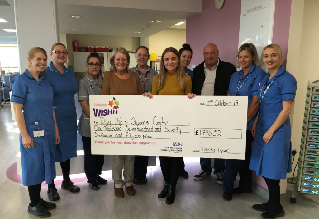 Fundraiser Becky Fyvie presents a cheque to nurses