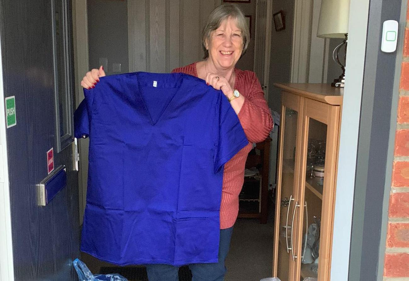 Volunteer Marilyn shows off her scrubs